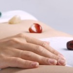 Alternative medicine - healing by semiprecious gems placed on body chakras, shallow depth of field
